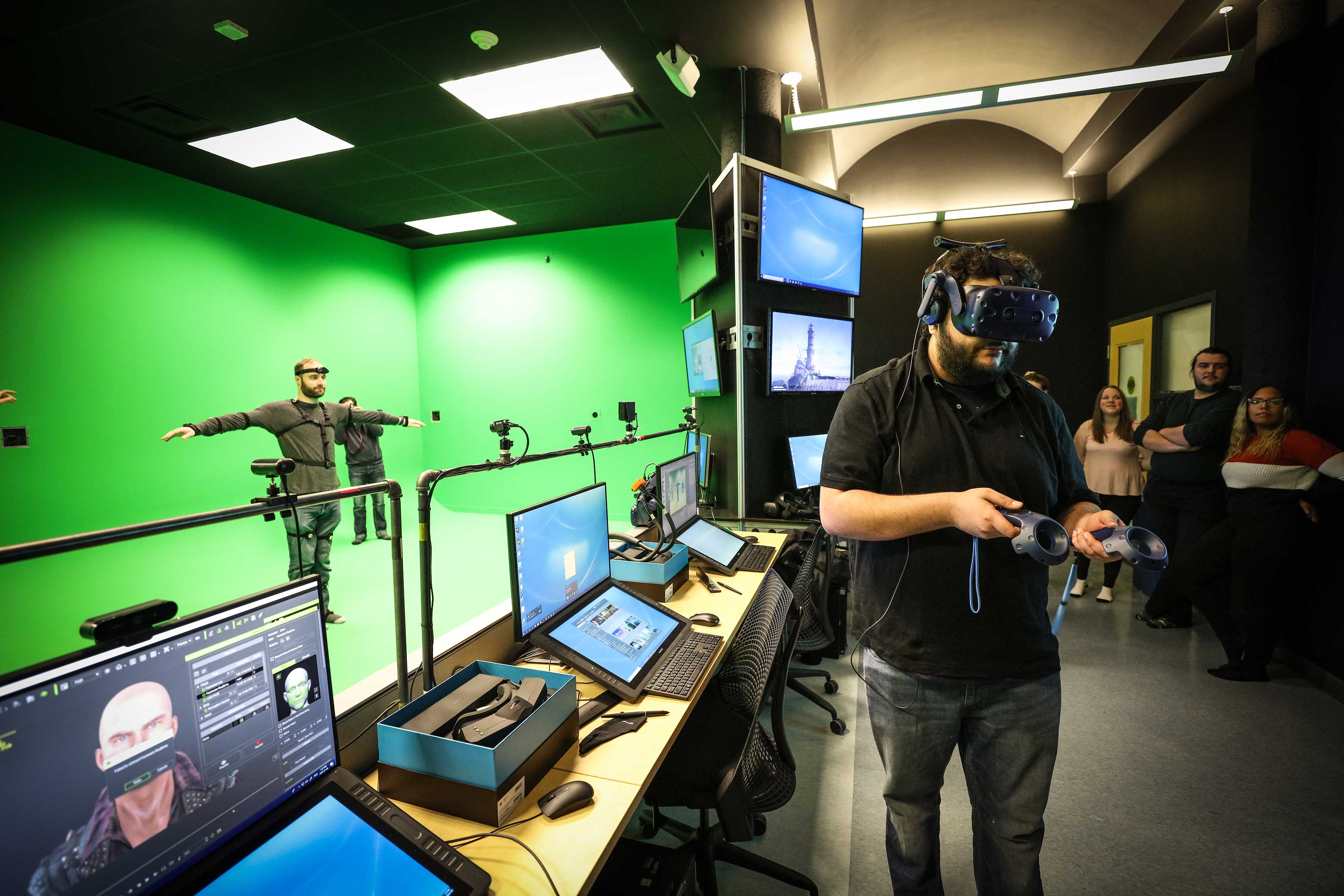 individuals wearing virtual reality headsets and equipment