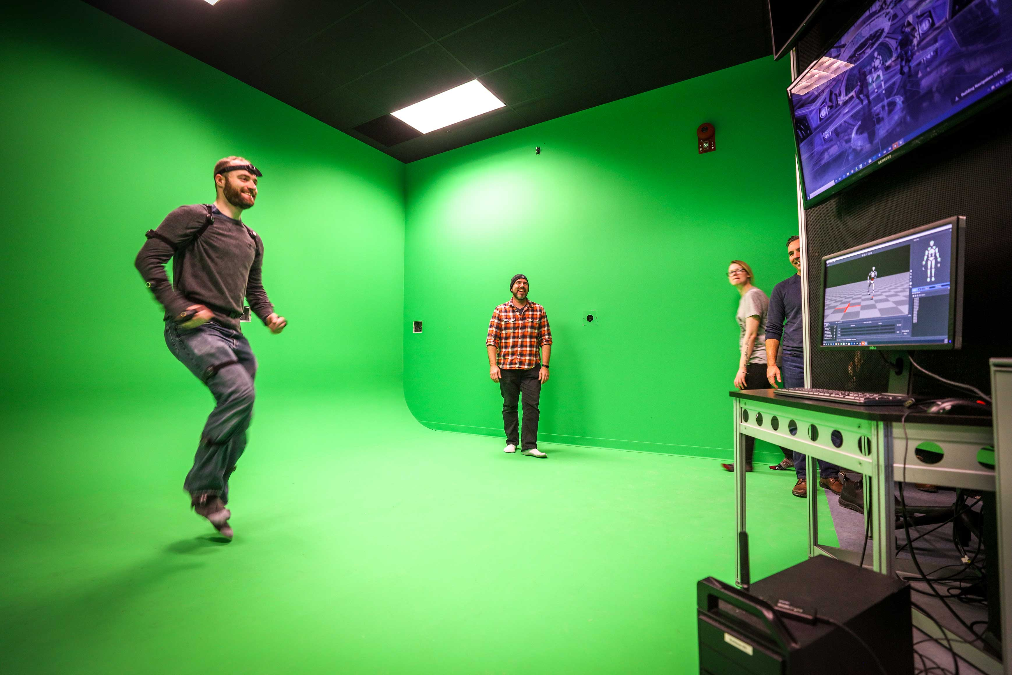 individual moving and jumping with virtual reality equipment on